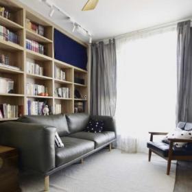 現代簡約客廳真皮沙發書柜背景墻