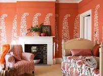 客厅背景墙橙色的卧室空间装修效果图