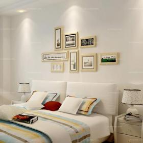 現代臥室白色照片墻相片墻床頭背景簡約之中的藝術人生裝修效果圖